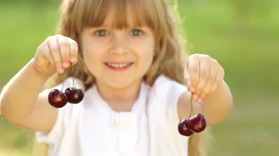 stock-footage-child-playing-with-a-sweet-cherry-fruit