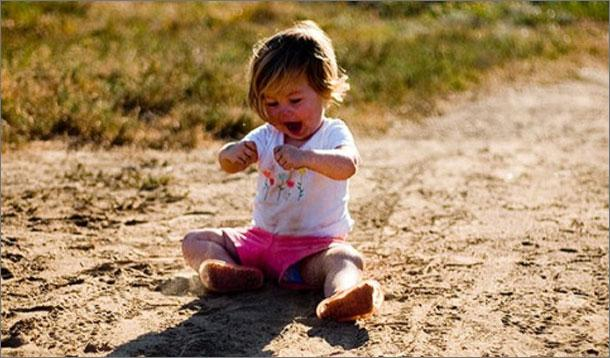 dirty_child_playing_outside